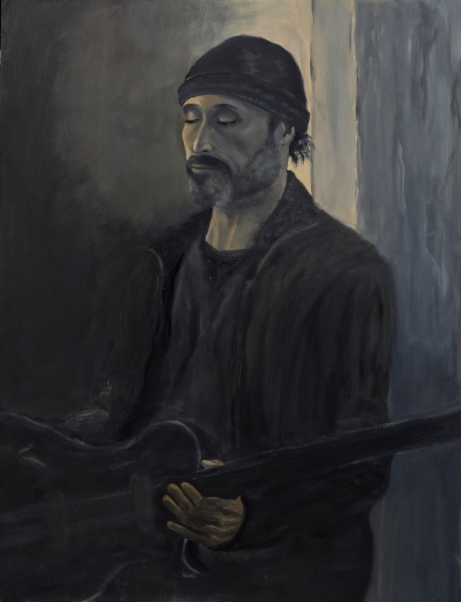 Guitar Player in a Black Hat